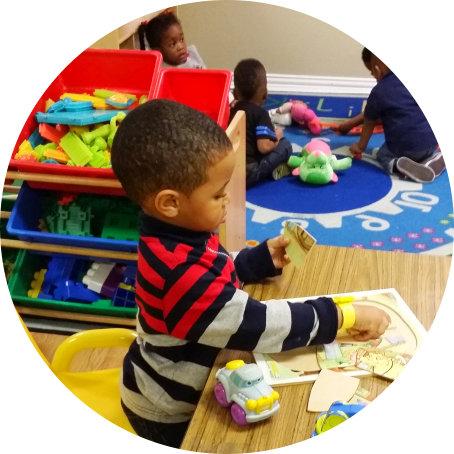 child doing puzzle